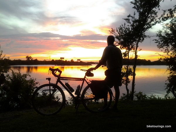 Picture of touring bike and rider with sunset