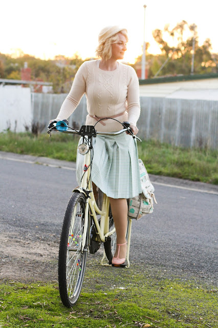 Liana of Finding Femme riding her Lekker bike in bubblegum pink Bettie Page shoes from Modcloth, Alannah Hill sweater, vintage mint midi skirt with basil pannier bags in Ballarat.