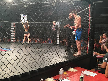 Glenn Curry in the Cage With Ring Girl
