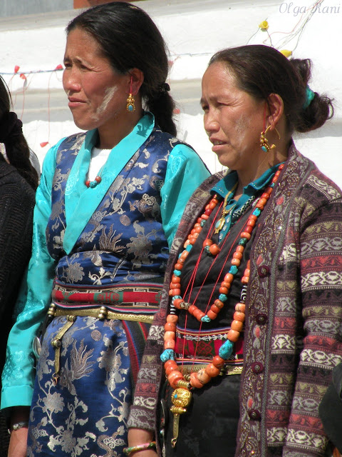 Tibetan women from Nepal wearing coral turquoise and dzi beads necklaces
