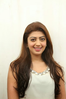 Actress Pranitha Pictures in White Dress at Homeo Trend Super Speciality Hospital Launch 0002