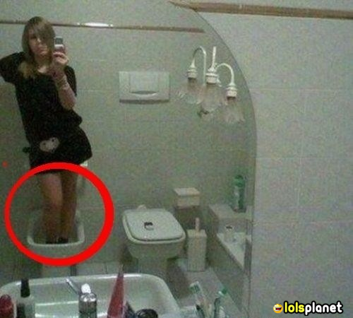 washroom photo fail, girl taking pictures of herself in bathroom but the height of the girl was not so enough to reach the mirror so he stand on the pot and took her picture, Fail because everyone can see what she did there.