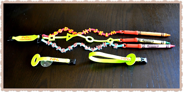 crayon bungee, crayon holder, crayons for airplane, keep crayons from falling, nini crayon bungee, travel crayon,