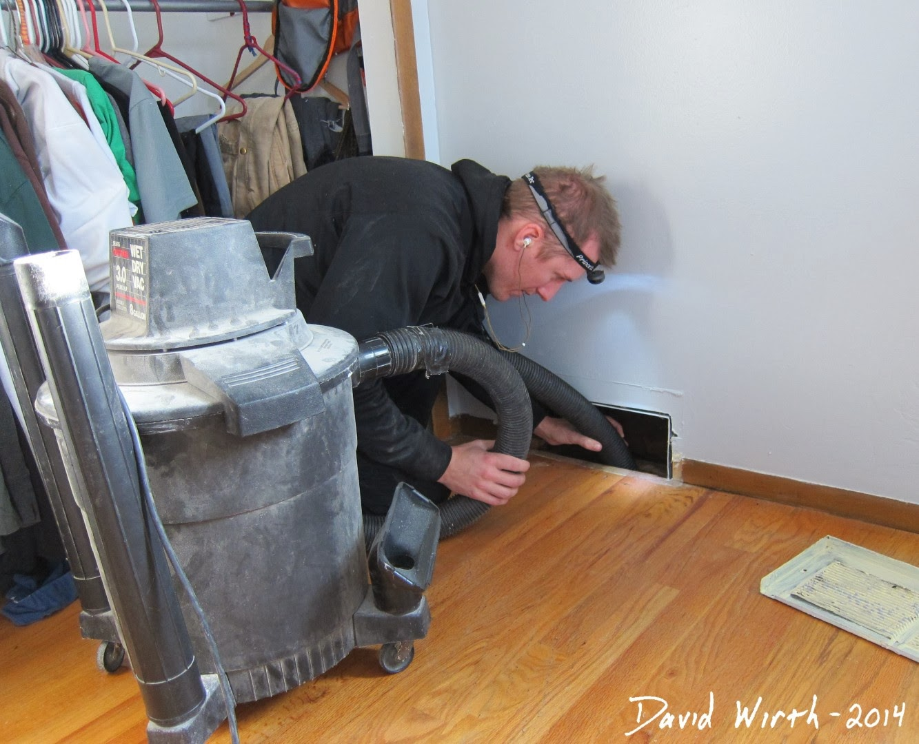 vacuuming out heat vents, air vents, shop vac, clean
