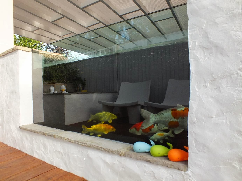 Alternative eden exotic garden the big koi pond reveal for Koi pond viewing window