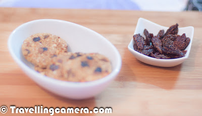 Recently we got a smart box of  'SmartEats' with different types of healthy snacks. This brand is getting very popular in short span of time and wealsoughtof trying the same. Here is what Monica says about SmartEats...  Oatmeal Chewy Cookies (A delicious, healthy & crunchy cookie packed withnutsandraisins): While the ingredients used in the cookies look interesting, they don't do much when youtakeabiteofthecookie.Itistoohardandthereforenotsomethingthat people would enjoy with their cup of tea. The mix of dry resins and nuts adds a good aroma to the finalproduct.ParsleyPepper Crackers (An ideal tea time snack with a combination of herbs & cheese in whole wheat base):  Using pepper to season crackers seems tobeveryinnovative idea. But the crackers could do with little more flavor of pepper. Whilethepepperisclearlyvisible on the cracker, the taste does not reallyjustify the name. This could make for a very interesting snack, if accompanies with a salsa orgarlicdip.But left on it's own, it leaves a very dry andneutral taste in the mouth. The look of the cracker makes you much more than the taste provides you with. Very Berry Strawberry (Speciallydehydratedfruitwith all the micronutrients intact. Great for having around the year):Dried prunes have always been a favorite choice for healthy snacking. Sothispackofdried strawberries comes as a refreshing change. They have a nice taste and texture & leave one feeling quite satisfied after a munch.Howeverthatsatisfaction lasts only to the time you don't have a look at the price tag on the packet. The product is quite steeply priced for the quantitybeingofferedand may not down well with an average consumer.  It might end up becoming a rich man's snack. Yummy Jaipuri Mixture (A roasted… not fried, mix of delicious and healthy lientils, seeds, grams & peanuts) :A nice blend of nuts and lentilsthat provides a healthy snacking option for all weight watchers. This snack goes down well with the cup ofteaanddrinksalike. Having said that there arelotsof similar options available in the market and this mix only adds to that range without providing anythingadditionalor more exciting foraconsumer.