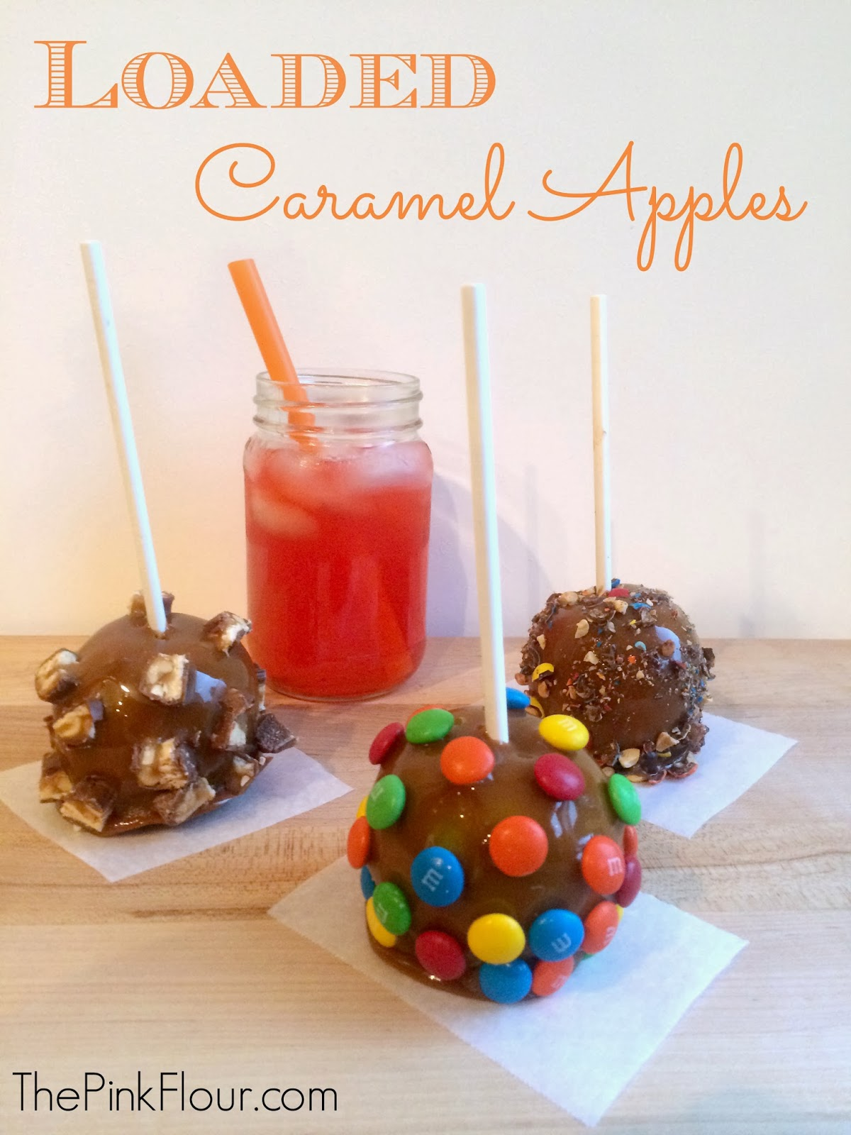 Loaded Caramel Apples - easy Halloween caramel apples topped with M&M's, Twix & Snickers from www.thepinkflour.com #shop