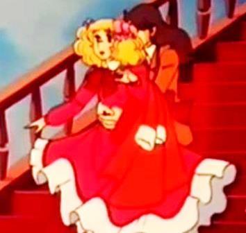 Imagen cuando Terry abraza a Candy bajando la escalera