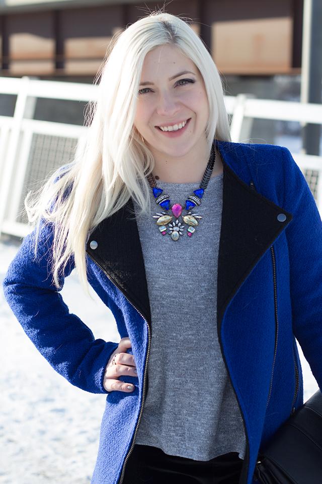Jennifer Ashley wearing a royal blue jacket (Forever 21) & colorful art deco necklace.