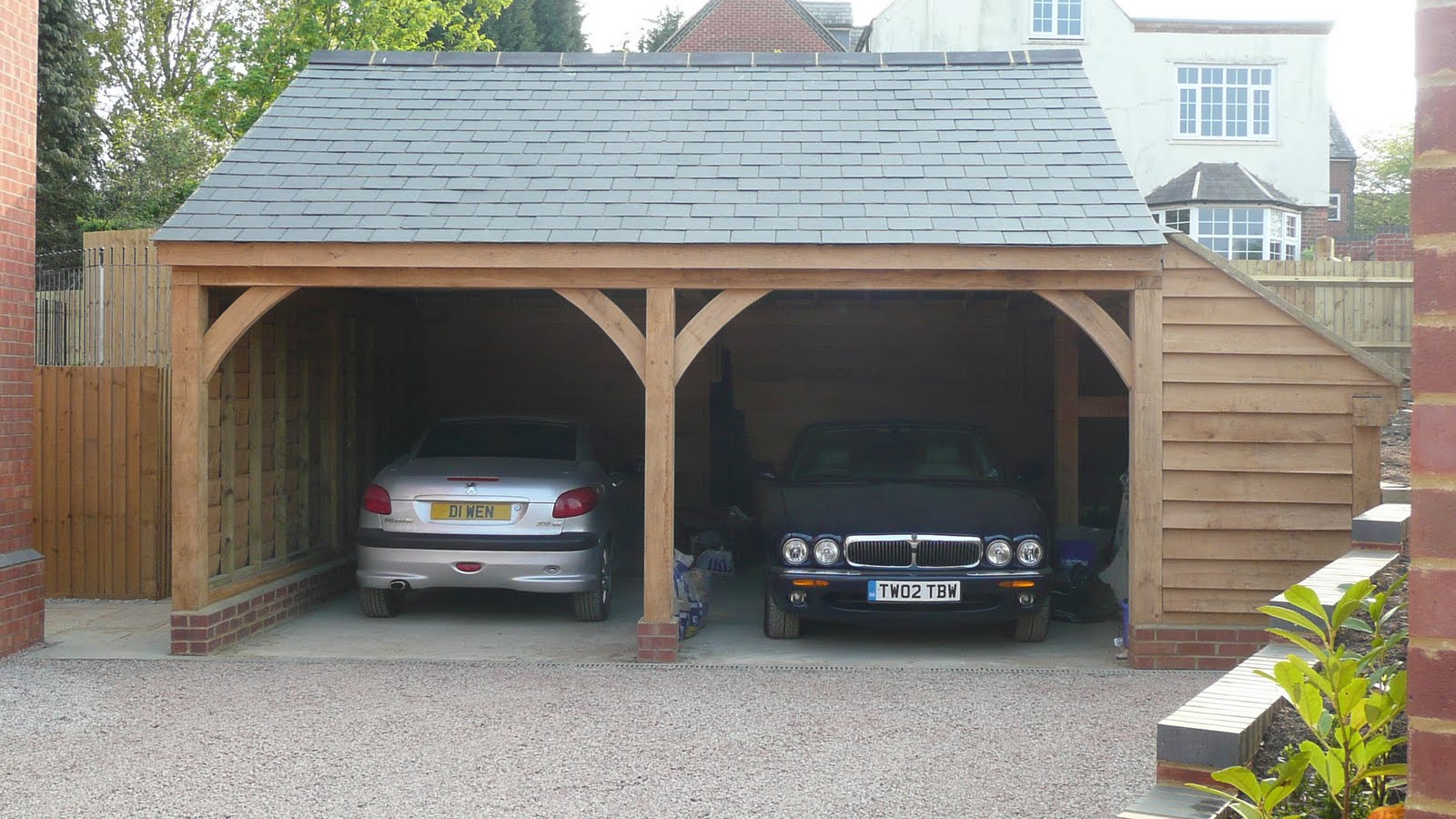 Father And Son Decking Complete. Cars In Garage  For First Time .