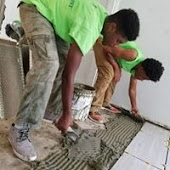 Michael and Jared laying tile in SC