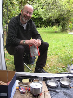 Mr A with the gas stove and pots
