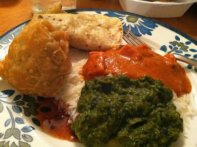 Chicken Tikka Masal and Aloo Palak, paired with a Muscat