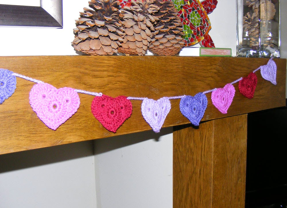Garland of crocheted valentine hearts over my fireplace