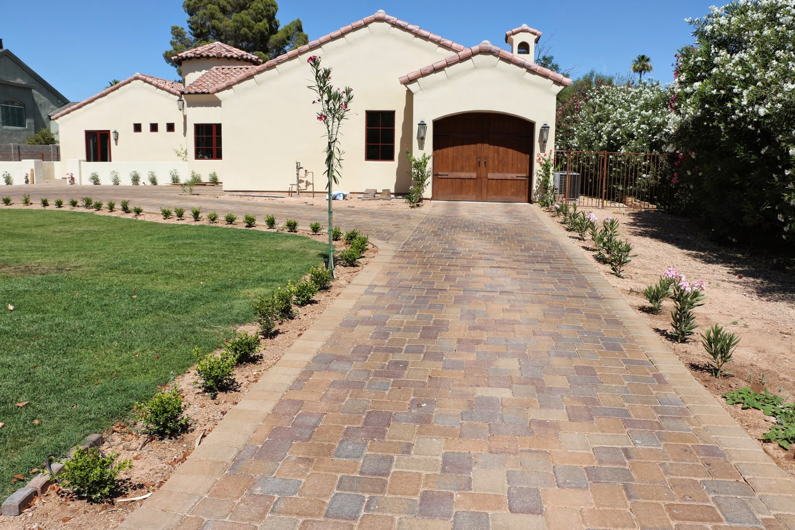 paver driveway, spanish colonial house