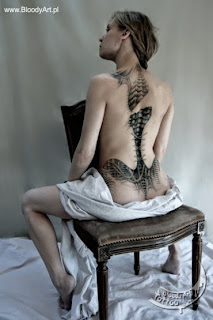 Full back biomechanical corset tattoo