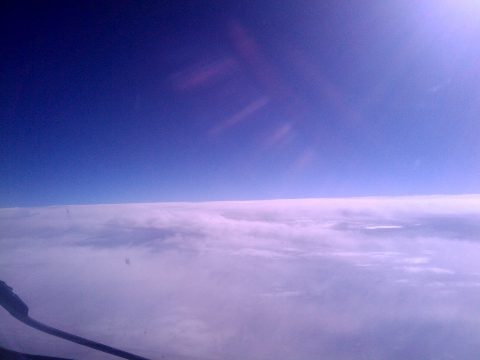 Airplane Window View of Clouds