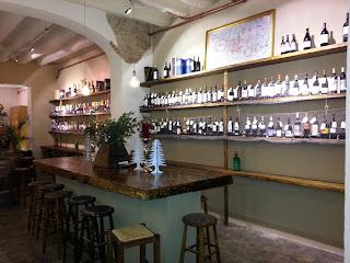 Wine bottles shelved at Els Sortidors de Parlament