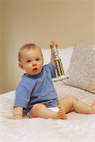 baby holding trophy