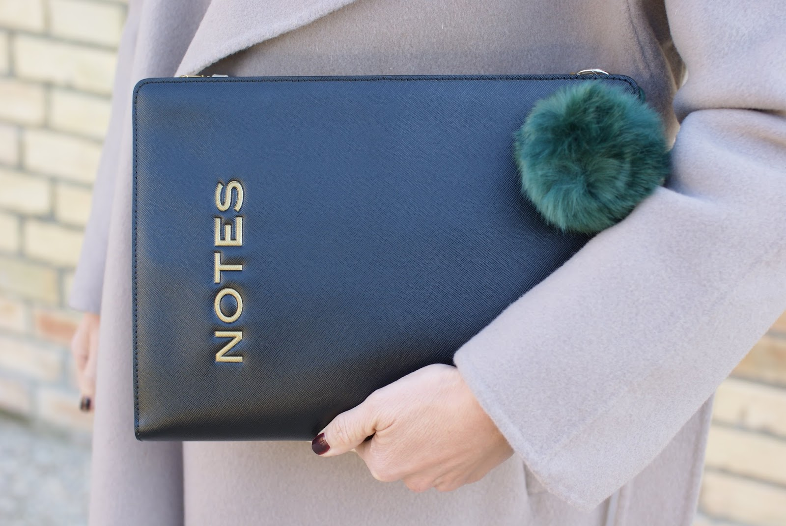 Notes clutch and faux fur charm on Fashion and Cookies fashion blog, fashion blogger style