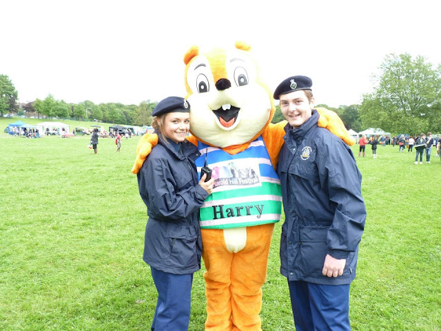 We had ten police cadets helping us at the Harold Hill Festival 2012. Here are a couple of them with Harry our Festival mascot.