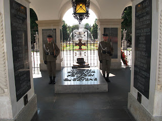 Military officers guard the Tomb of the Unknown Soldier in Poland.