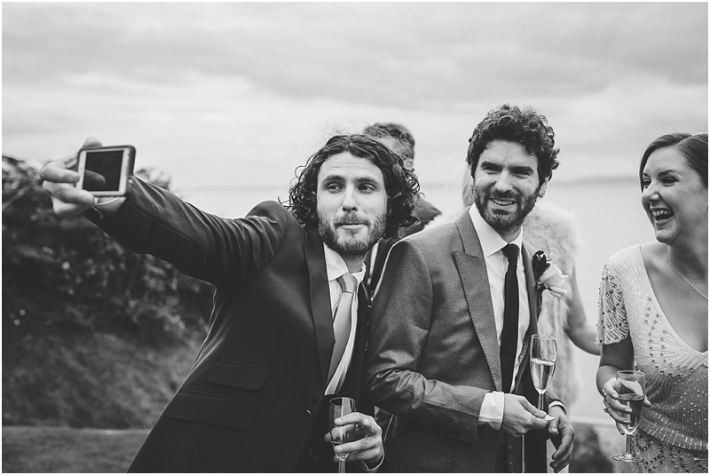 Best man takes selfie with bride and groom