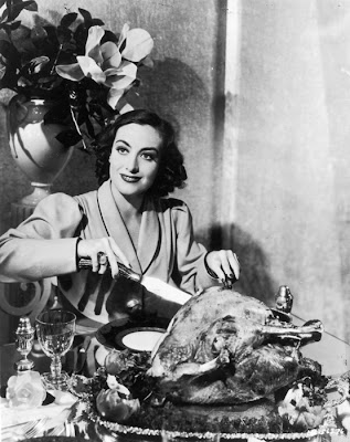 Joan Crawford carving turkey