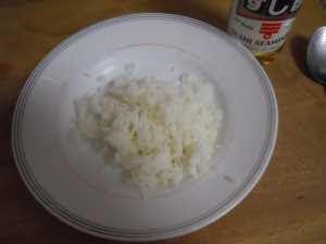 Aliñar el arroz.