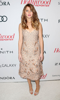 Jennifer Lawrence looking striking in a nude dress from Valentino's spring 2013 collection when attend The Hollywood Reporter Nominees' Night 2013