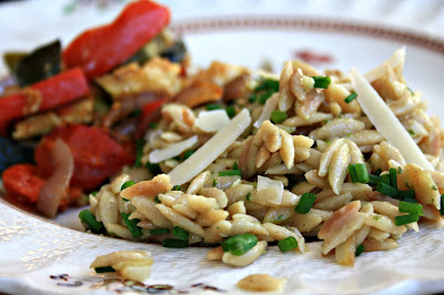 Orzo pasta with parmesan and basil is easy to prepare, delicious and goes with just about anything