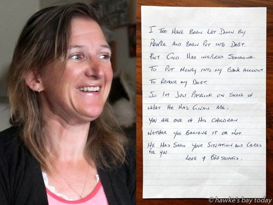 "Sarah de la Haye, who has cerebral palsy, pictured opening an anonymous gift of $1000 after she lost a bathroom renovation deposit when Mercy Renovators went into voluntary liquidation. The note reads, ""I too have been let down by people and been put into debt. But God has inspired someone to put money into my bank account to remove my debt. So, I'm just passing on some of what He has given me. You are one of his children, whether you believe it or not. He has seen your situation and cares for you. Love and Blessings."" photograph"