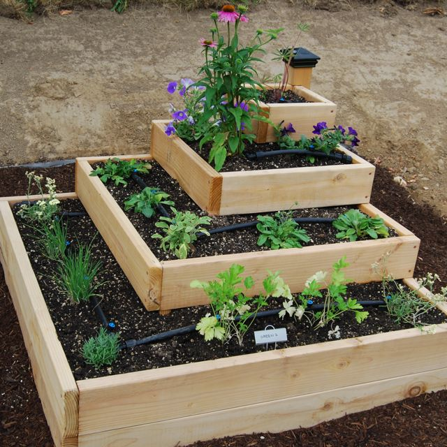 Raised herb garden design photograph tiered love this ph for Tiered garden designs
