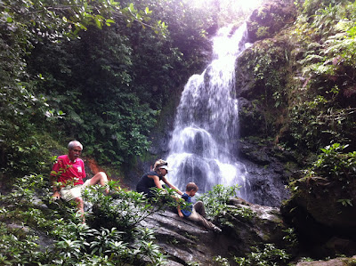 McKinley Pritchard rests at the 75 Foot Tall Waterfall in Belize