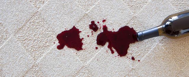 Wine spilled on light, patterned carpet