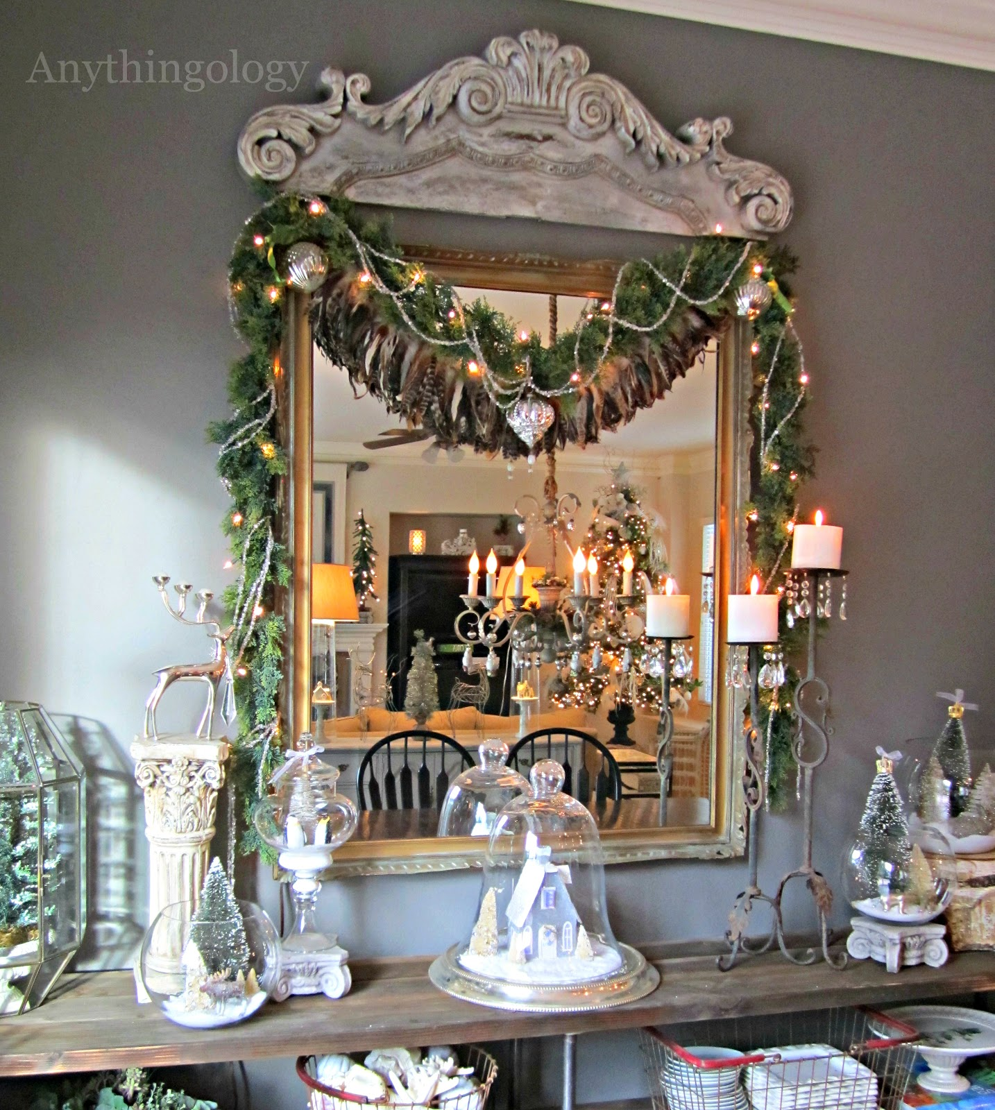 Vintage The chandelier is blinged out with faux greenery and Christmas owls