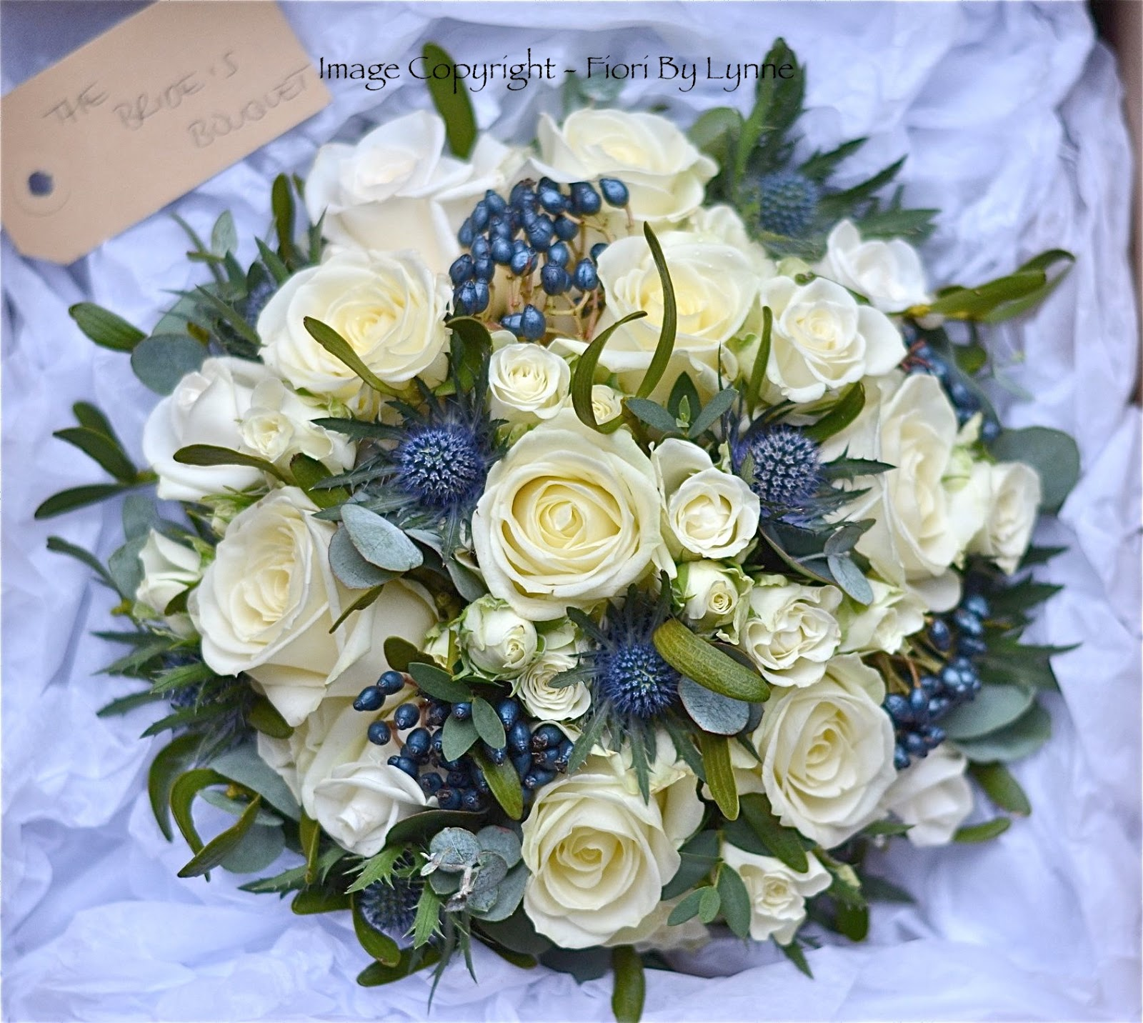 Wedding Bouquet Of Ivory Roses Thistles Navy Berries Eucalyptus And