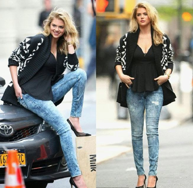 In Nineties revival, the model, Kate Upton wore stonewash skinny jeans and a plunging black top for the New York City shoot at Manhattan, New York on Tuesday, May 6, 2014.
