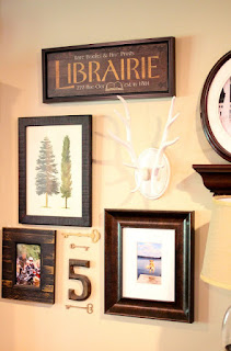 gallery wall with antlers and wooden number via www.goldenboysandme.com