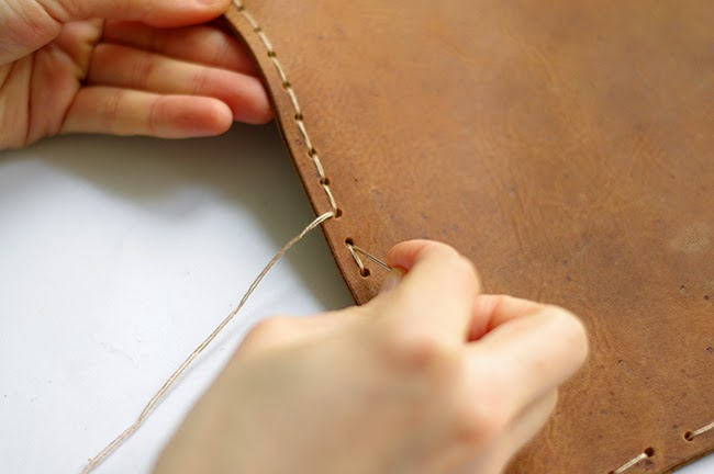 How to sew a leather envelope clutch with hand strap. Tutorial designed by Xenia Kuhn for fashion blog www.fashionrolla.com