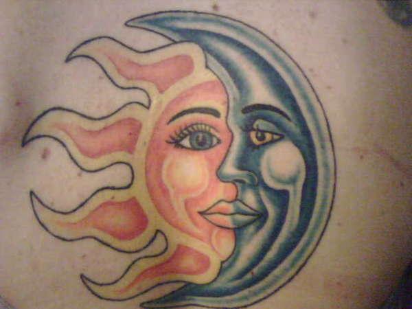 Sun and moon tattoos on feet