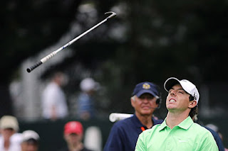 Rory McIlroy flings his club after chipping towards the 4th green. He shot 76 in the final round at the US Open to finish 14 over par. Photograph: Rob Carr/Getty Images