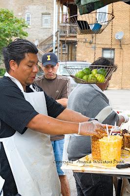 pushcart vendor making fruit cups  in Rogers Park, Chicago