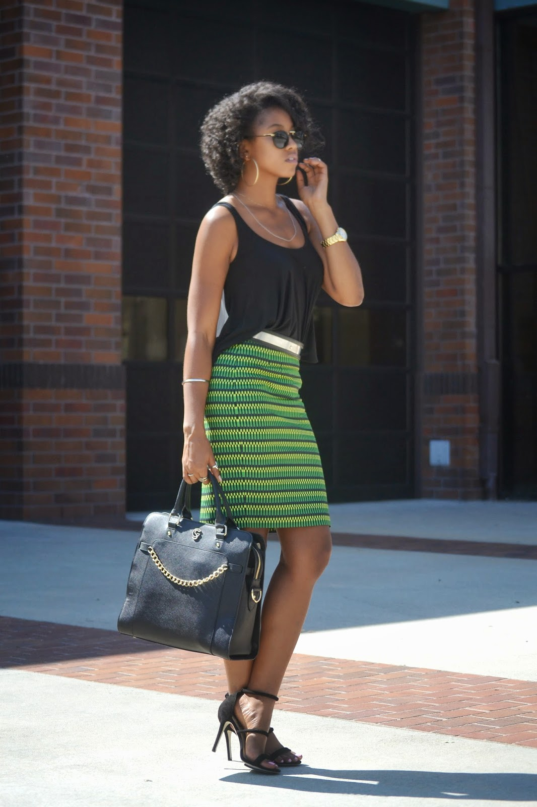 black-full-hem-tank-high-low-hem-printed-green-pencil-skirt-metallic-belt