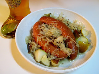 Beer bratwursts with sauerkraut & pear