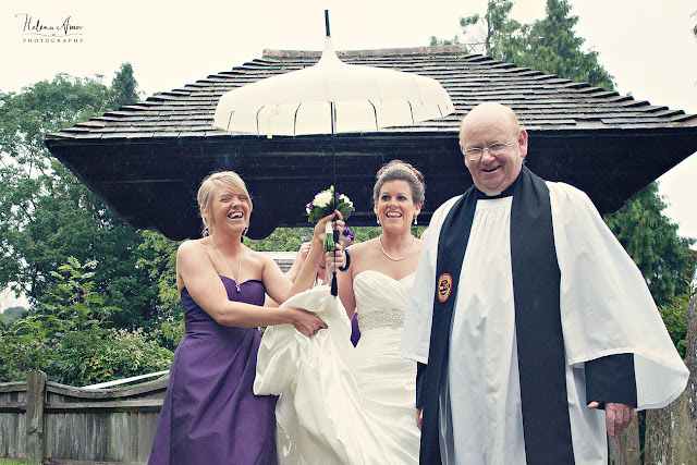 bride arriving with bridesmaid at St Leonards church Bursledon