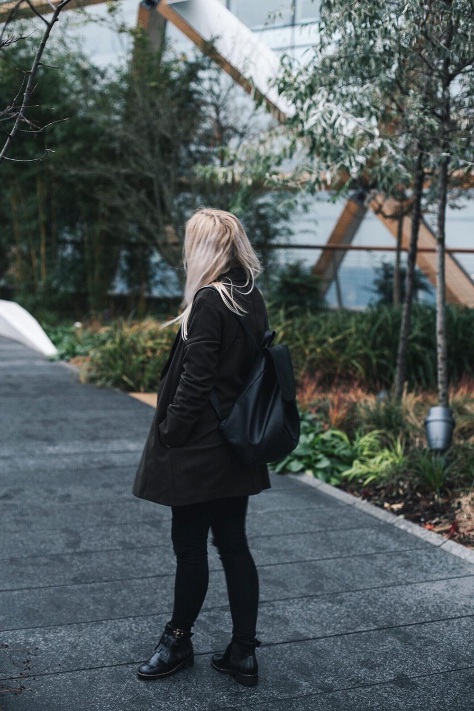 Khaki Uniqlo x Lemaire coat, Zara backpack outfit