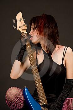 Guitar with a beautiful girls wallpaper