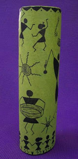 Warli painting on a recycled vase. warli motifs in celebration mood