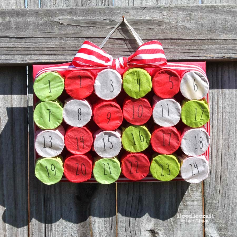 Doodlecraft tp roll christmas countdown advent calendar now when december 1st rolls around the kids can take turns poking their finger through the tissue paper jeuxipadfo Image collections